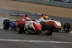 Daisuke Nakajima and Esteban Gutierrez race to the finish line on the last lap