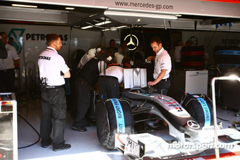 Mechanics looking at Michael Schumacher, Mercedes GP car