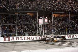 Denny Hamlin, Joe Gibbs Racing Toyota, takes the checkered flag