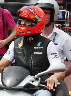 Michael Schumacher, Mercedes GP rides around the circuit with Andrew Shovlin, Mercedes GP, Senior Race Engineer to Michael Schumacher