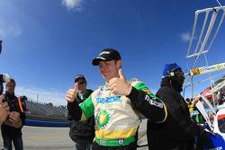 Guy Smith celebrates winning the pole