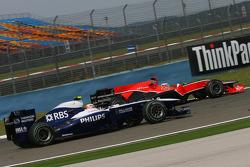 Nico Hulkenberg, Williams F1 Team and Timo Glock, Virgin Racing