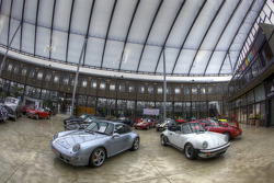 Porsche cars in the main hall