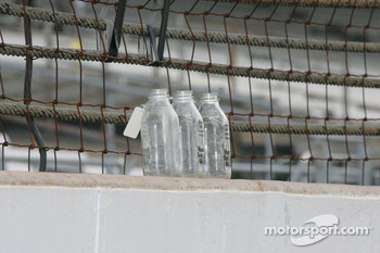 Milk bottles tagged from Vicotory Circle sit on the wall