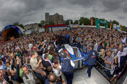 #2 Team Peugeot Total Peugeot 908 is unloaded while a massive number of fans watch