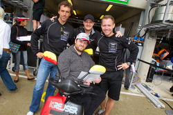 Peter Kox, Tomas Enge and Christoffer Nygaard pose with a fan