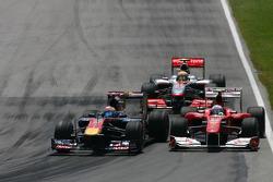 Sebastien Buemi, Scuderia Toro Rosso and Fernando Alonso, Scuderia Ferrari