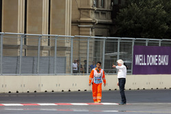 Charlie Whiting, FIA Delegate inspects the circuit after GP2 qualifying is postponed