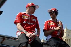 Kimi Raikkonen, Scuderia Ferrari and team-mate Sebastian Vettel, Scuderia Ferrari