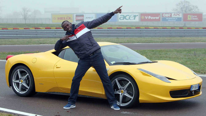 Usain Bolt with a Ferrari 458