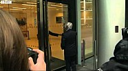 Bernie Ecclestone fails to get through a door