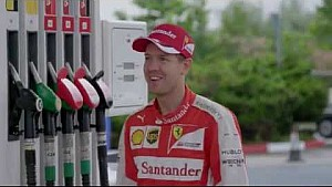 Vettel surprises people at Shell filling station