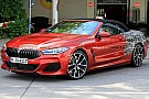 BMW 8 Series Convertible spied wearing a seductive red dress