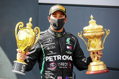 British GP: Hamilton wins on three wheels after late drama