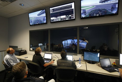 Fernando Alonso in the Honda Performance Development simulator as the engineers watch from the control room
