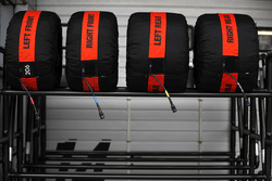 Pirelli tyres in their warmers on a rack