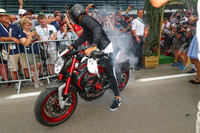 Lewis Hamilton, Mercedes AMG F1 arrives on his MV Agusta Dragster RR LH44 Limited Edition motorbike and performs a burn out for the fans