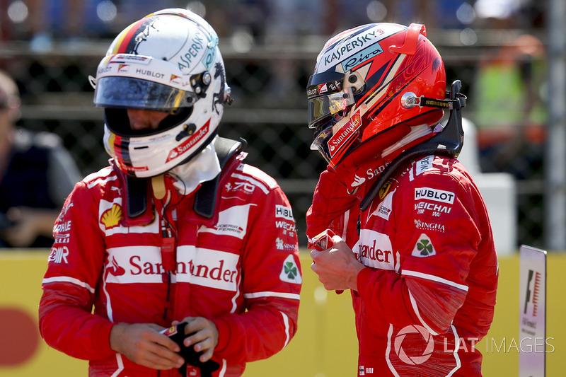 Le poleman Sebastian Vettel, Ferrari, le second Kimi Raikkonen, Ferrari