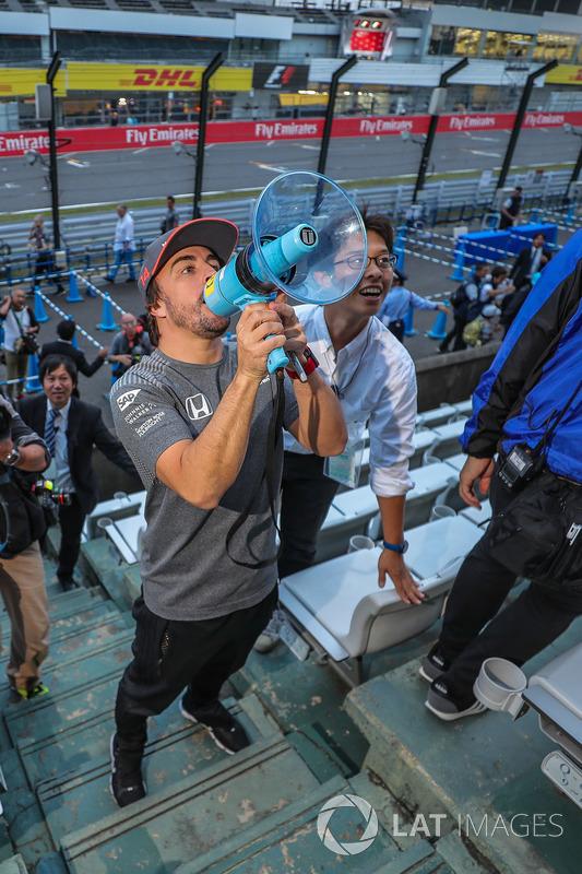 Fernando Alonso, McLaren talks to the fans using a megaphone