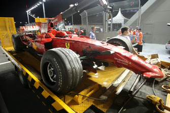 The car of Kimi Raikkonen, Ferrari F2008 is recovered after he crashed out of the race