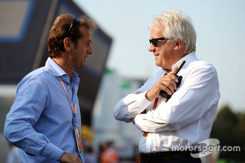 (L to R): Jarno Trulli, with Charlie Whiting, FIA Delegate