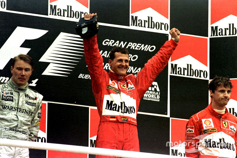 Podium: Race winner Michael Schumacher, Ferrari; second place Mika Hakkinen, McLaren; third place Eddie Irvine, Ferrari