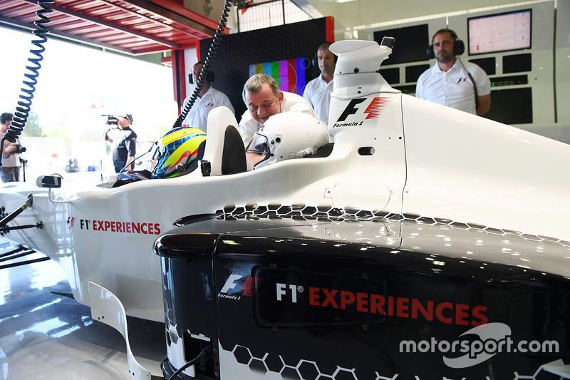 Zsolt Baumgartner, F1 Experiences 2-Seater driver and F1 Experiences 2-Seater passenger Will Buxton, NBC TV Presenter