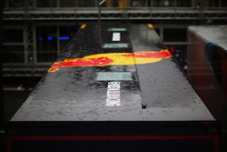 Rain falls on the Red Bull Racing transporter in the paddock