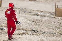 Гонщик Ferrari Кими Райкконен возвращается в боксы