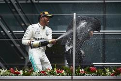 Podium: Lewis Hamilton, Mercedes AMG, sprays Aldo Costa, Engineering Director, Mercedes AMG, with Champagne on the podium