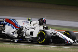 Lance Stroll, Williams FW40, climbs from his crashed car