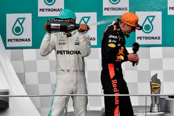 Lewis Hamilton, Mercedes AMG F1 and Max Verstappen, Red Bull Racing celebrate on the podium, the champagne