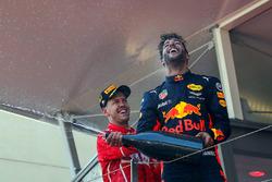 Race winner Sebastian Vettel, Ferrari and Daniel Ricciardo, Red Bull Racing