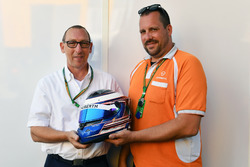 Frank Klute is presented with his prize of a Schuberth Helmet with JMD paint design to be auctioned for Make a Wish Charity UAE