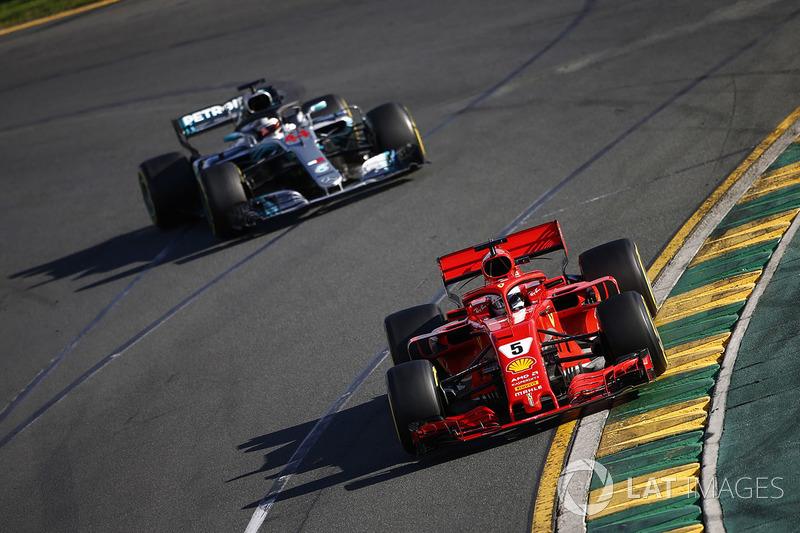 Sebastian Vettel, Ferrari SF71H, leads Lewis Hamilton, Mercedes AMG F1 W09