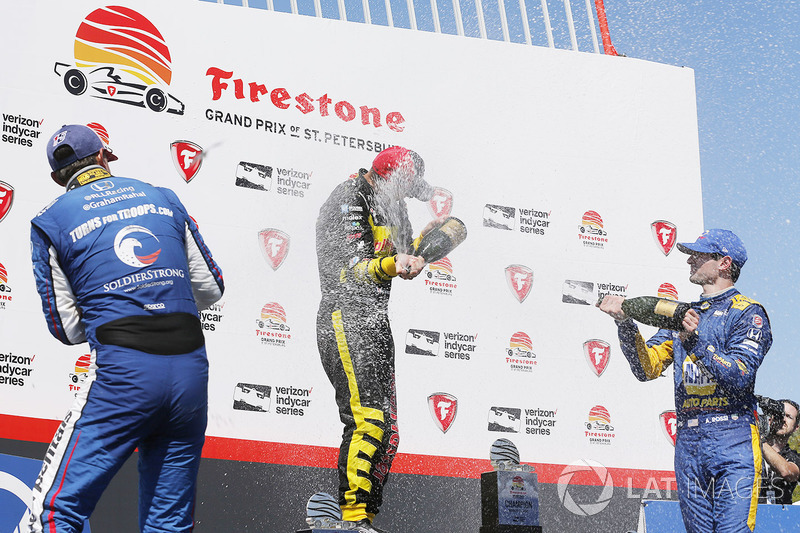 Sébastien Bourdais, Dale Coyne Racing with Vasser-Sullivan Honda, Graham Rahal, Rahal Letterman Lanigan Racing Honda, Alexander Rossi, Andretti Autosport Honda celebrate with champagne on the podium