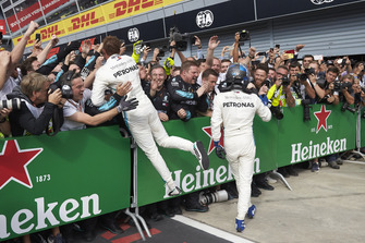 Lewis Hamilton, Mercedes AMG F1, and Valtteri Bottas, Mercedes AMG F1, celebrate in parc ferme