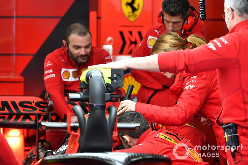 Ferrari engineers work on Sebastian Vettel's Ferrari SF1000
