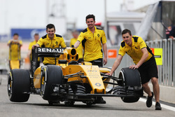 The Renault Sport F1 Team RS16 is pushed down the pitlane