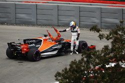 Fernando Alonso, McLaren MCL32, climbs out of his car after stopping in FP1, technical issues