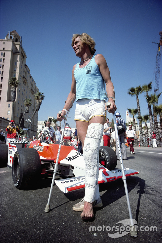 James Hunt, wearing a leg cast following a skiing accident