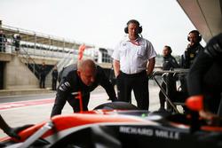 Zak Brown, Executive Director, McLaren Technology Group, looks on as Stoffel Vandoorne, McLaren MCL32