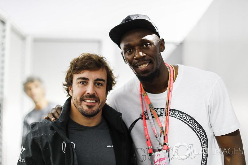 Fernando Alonso, McLaren, con Usain Bolt