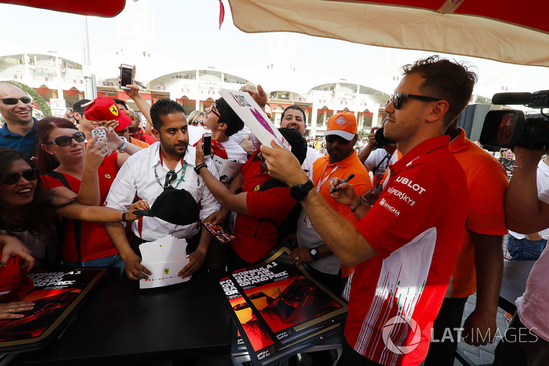 Sebastian Vettel, Ferrari, signs autographs for fans