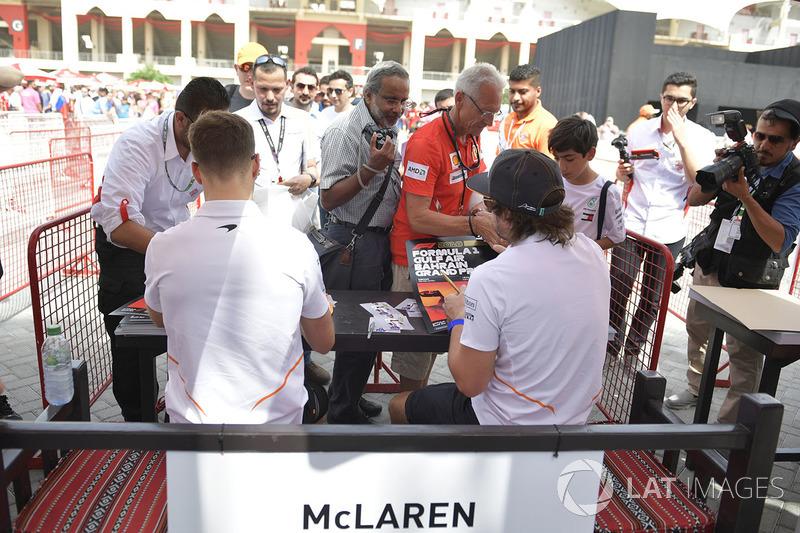 Fernando Alonso, McLaren and Stoffel Vandoorne, McLaren sign autographs for the fans