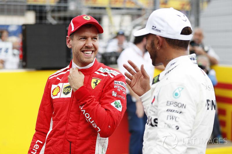 Third place Sebastian Vettel, Ferrari, and pole sitter Lewis Hamilton, Mercedes AMG F1