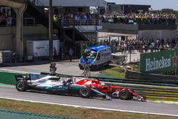 Sebastian Vettel, Ferrari SF70H and Valtteri Bottas, Mercedes-Benz F1 W08  battle for the lead at the start of the race