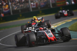 Kevin Magnussen, Haas F1 Team VF-18 Ferrari, leads Max Verstappen, Red Bull Racing RB14 Tag Heuer