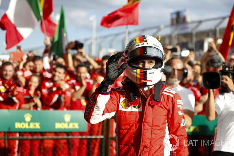 Sebastian Vettel, Ferrari, 1st position, celebrates with his team in Parc Ferme
