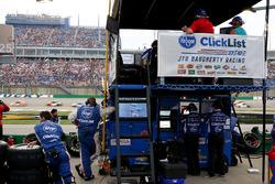 A.J. Allmendinger, JTG Daugherty Racing Chevrolet Camaro pit crew watches on.